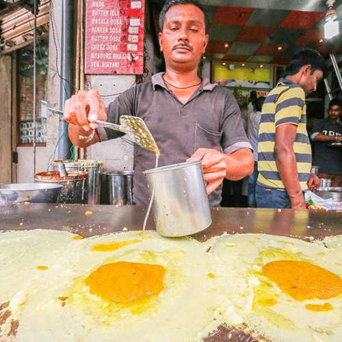 culture indian chef making omelette